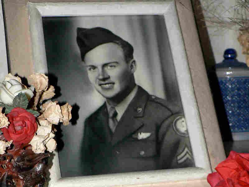 A photo of Jerry Sorensen rests at his gravesite in Ganshoren, near Brussels.