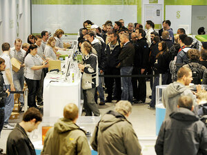 Customers line up Friday to buy Apple's new iPad as it is launched in Berlin.