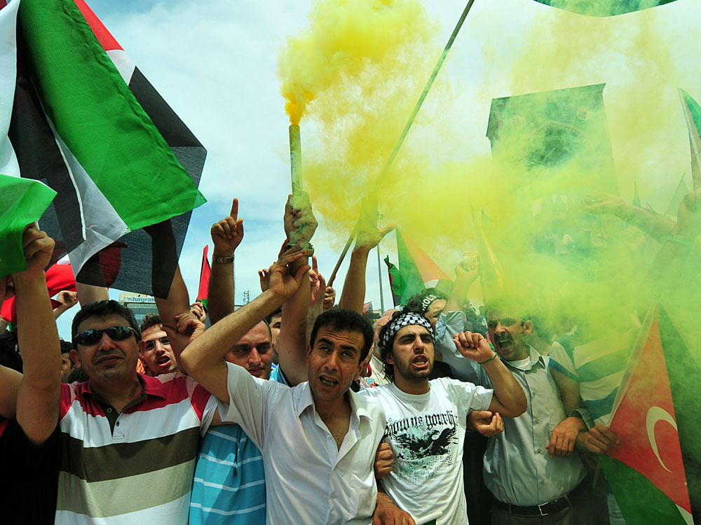 Turkish demonstrators shout slogans during an anti-Israeli