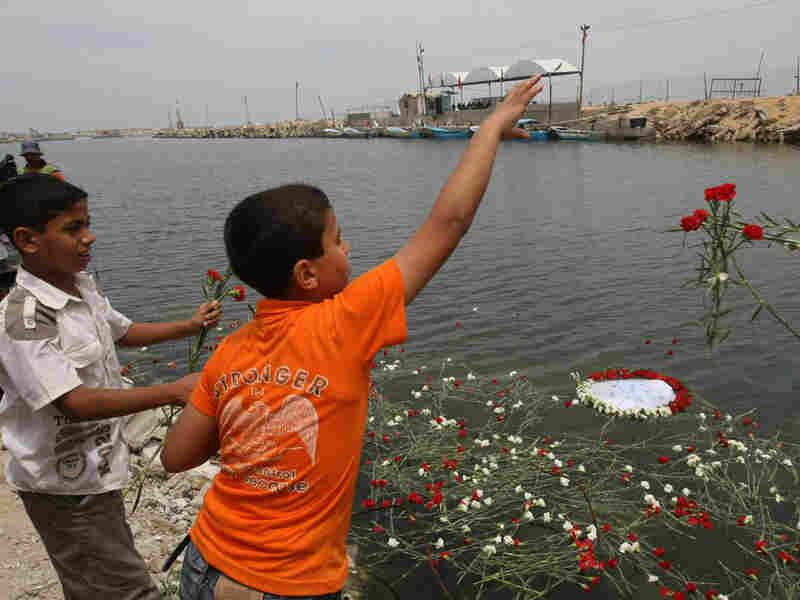Palestinian boys throw flowers