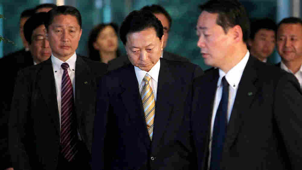 Japanese Prime Minister Yukio Hatoyama (center) leaves his official residence in Tokyo.
