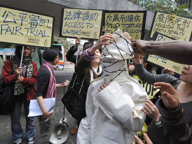 Protesters from Amnesty International in Hong Kong demonstrate in March 2009 against the death penalty in China. The human-rights group says China executed more than 1,700 people in 2008, roughly three-quarters of the world total.