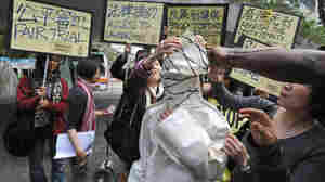 Human-rights advocates from Amnesty International in Hong Kong protest the death penalty in China.