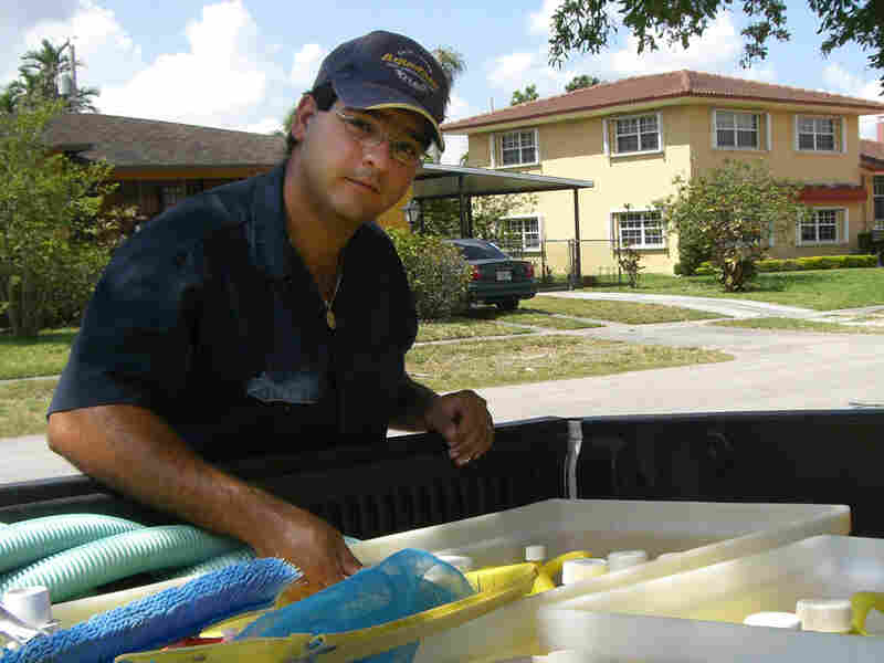 Yoelvis Bengochea works for his family business cleaning pools.