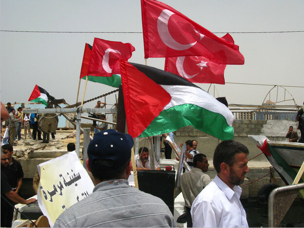 Turkish flags fly from Palestinian boats in the Gaza port as Gazans show solidarity with the Turkish activists who were killed Monday trying to break Israel's blockade.