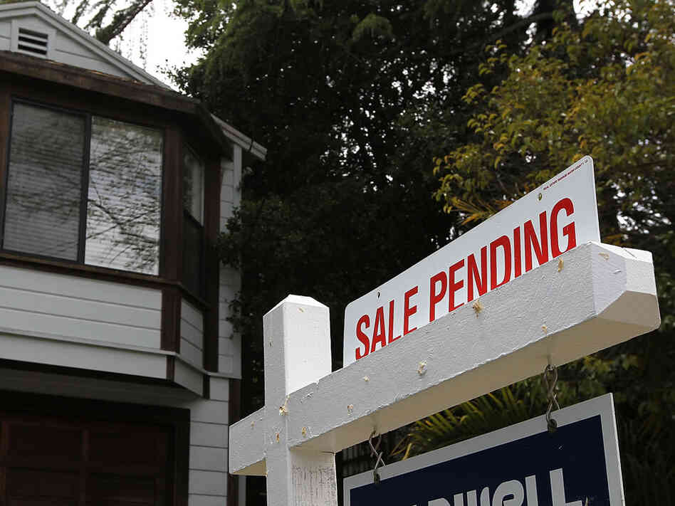 A ''sale pending'' sign hangs outside a home in San Rafael, Calif., on May 24.