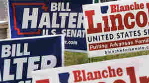 A cluster of Bill Halter and Blanche Lincoln campaign signs.