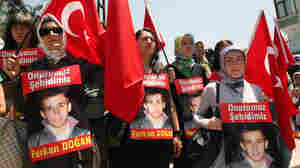 Mourners at the funeral of Furkan Dogan