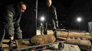 Bomb-disposal experts load a bomb after defusing it on Museum Island in Berlin, April 25, 2009