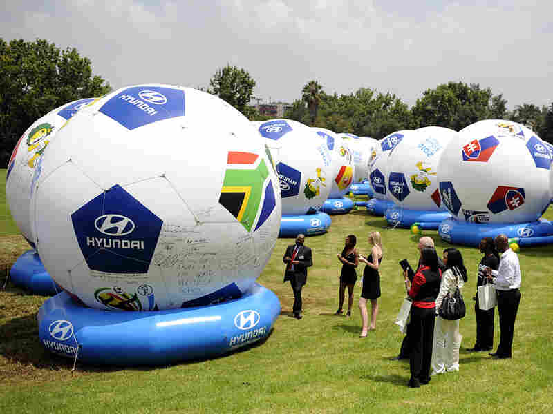 Fans in South Africa sign 32 Goodwill Balls, representing the qualified nations for the 2010 Cup.