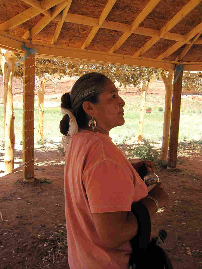 Lupita McClanahan in a shelter her husband built.