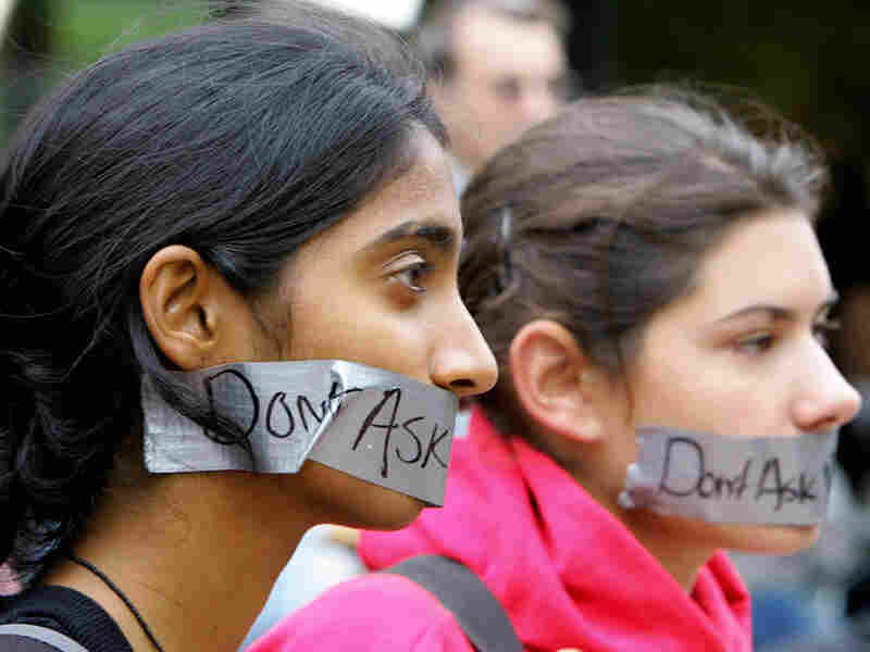 """Harvard Law students Vaidya Gullapalli and Kristin Small protest the """"don't ask, don't tell"""" policy."""