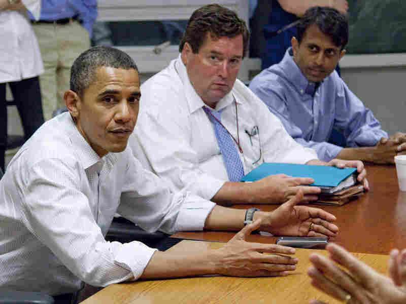 President Obama, accompanied by Billy Nungesser and Bobby Jindal, receives a briefing on the oil