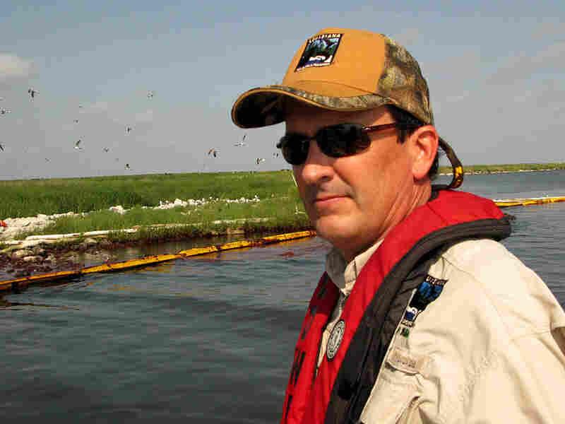 Michael Carloss was a surrogate parent for pelicans more than 30 years ago.  Elizabeth Shogren/NPR