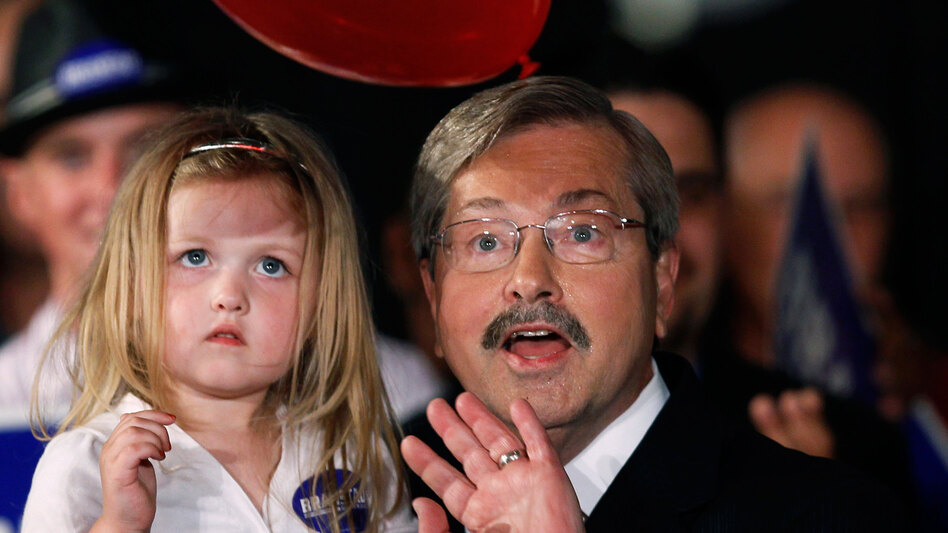 Former Iowa Gov. Terry Branstad celebrates his GOP primary victory with granddaughter MacKenzie.
