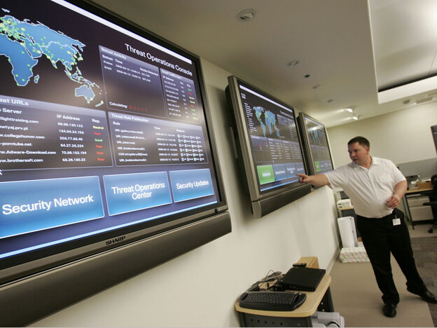 Employee Sean Tippett works in an operations room at the headquarters of Cisco Systems, a leading provider of Internet network technology, in San Jose, Calif. Experts are debating the need for Internet traceability for security purposes -- and what that would mean for online anonymity and civil liberties in places such as China and Iran.