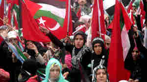 Pro-Palestinian demonstrators wave Turkish and Palestinian flags during a protest  in Ankara.