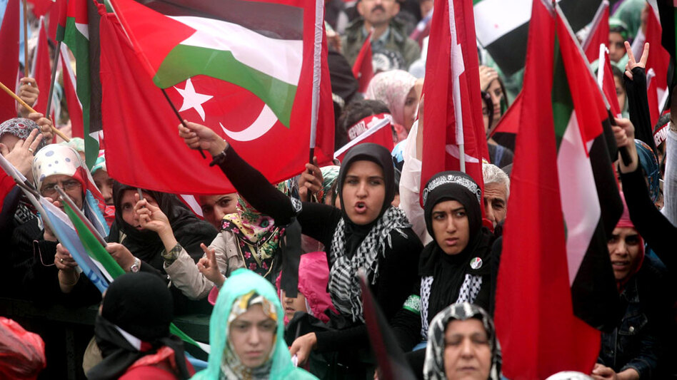 Pro-Palestinian demonstrators wave Turkish and Palestinian flags during a protest Sunday in Ankara against Israel's deadly raid on a Gaza-bound aid ship. The attack was the latest blow to U.S.-Turkish relations.