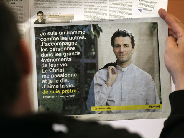 A French newspaper displays an advertisement recruiting young men to be Catholic priests. The French church has launched a public relations campaign to try to update the image of the priest and reverse the decline in numbers of French men entering the vocation.