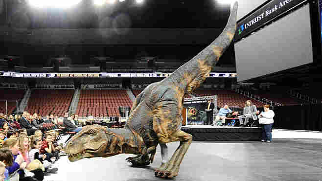 Stephen Hershey wearing the dinosaur costume.