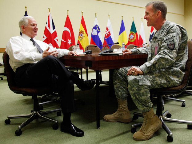 Gen. Stanley McChrystal (right), commander of U.S. and NATO forces in Afghanistan, meets Thursday with Defense Secretary Robert Gates at NATO headquarters in Brussels.