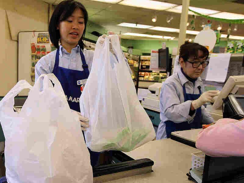 A cashier bags groceries last week in San Francisco.