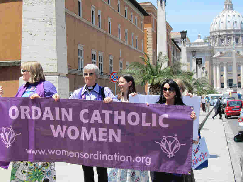 Women demanding female priesthood demonstrate in front of St. Peter's Basilica.