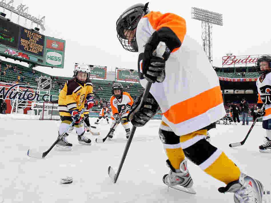 Youth teams play before the New Year's Day Winter Classic NHL hockey game.
