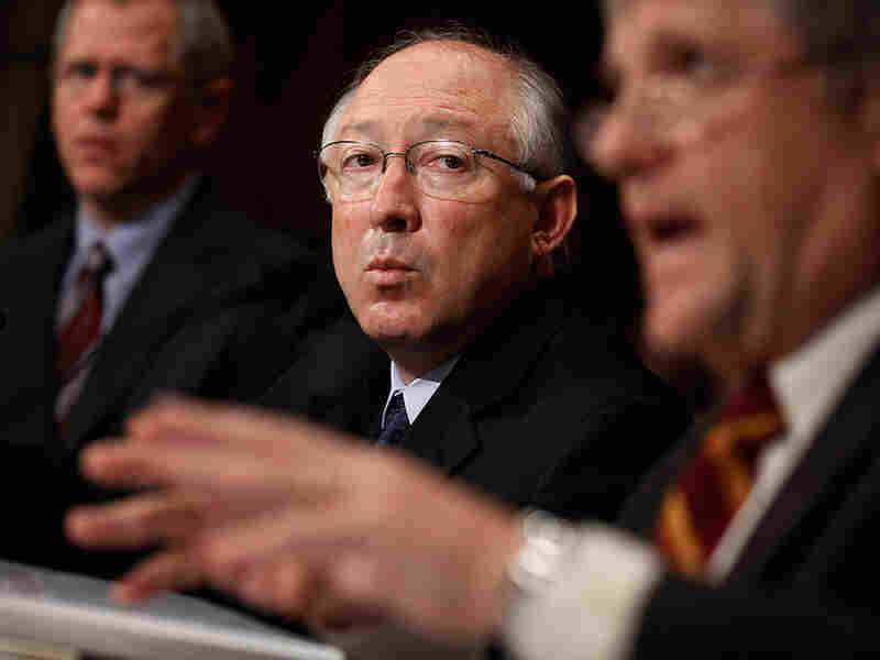 Interior Secretary Ken Salazar (center) and other Interior officials testifies on Capitol Hill.