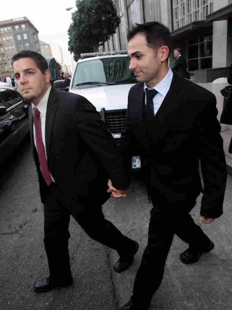 Plaintiffs Jeffrey Zarrillo, left, and Paul Katami leave the federal courthouse in San Francisco.
