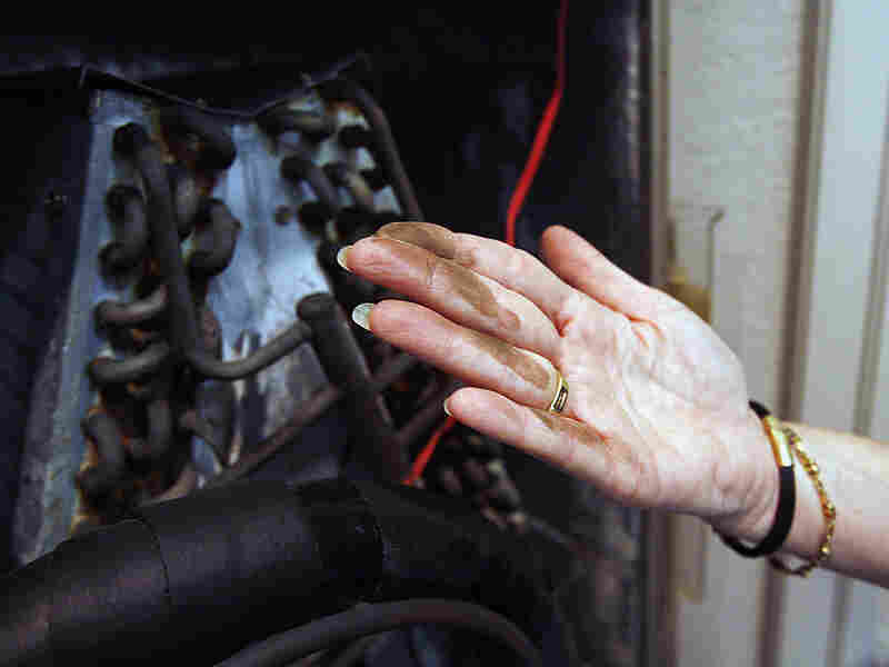 A Florida homeowner displays the corrosionon her air conditioner's coils caused by Chinese drywall.