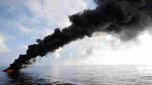 Smoke rises from a controlled burn of oil in the Gulf on May 5.