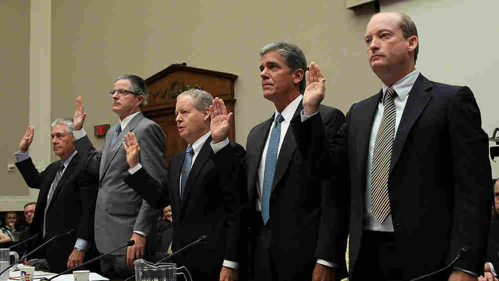 Oil company executives are sworn in for a hearing Tuesday before a House committee hearing