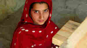 Rukia Begum, 16, sits before a loom at a craft center in Islampur