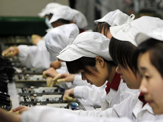 Employees work on the production line at the Foxconn complex in the southern Chinese city of Shenzhen. A string of suicides has plagued the electronics company's main facility in China.