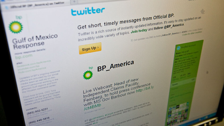 NPR photo illustration: A user browses the BP Twitter site.