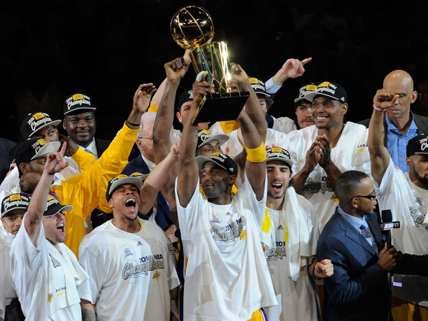 The Los Angeles Lakers celebrate winning the NBA championship, 83-79, over the Boston Celtics on Thursday at Staples Center in Los Angeles.