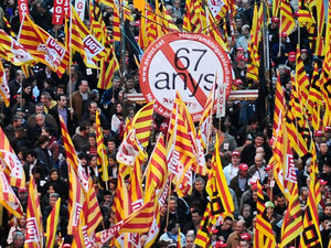 People protest against government plans to raise the retirement age in Barcelona, Spain.