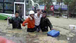 China Flooding Leaves 132 Dead, Forces Evacuations