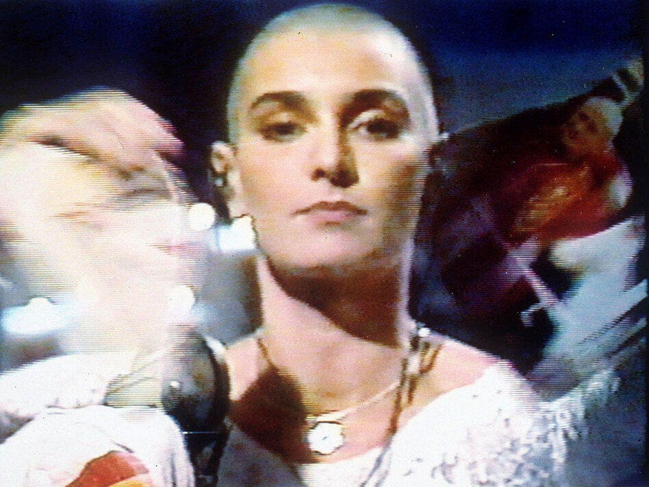 In this Oct. 5, 1992, image from video released by NBC, singer Sinead O'Connor tears up a photo of Pope John Paul II during a live appearance on <em>Saturday Night Live</em>. (NBC/AP)