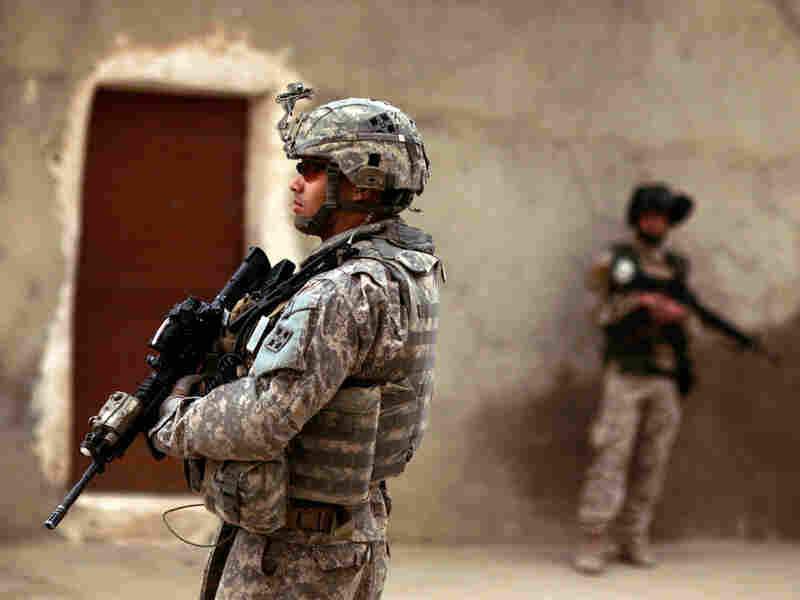 An Iraqi Army soldier and a U.S. Army soldiers in Mosul, Iraq