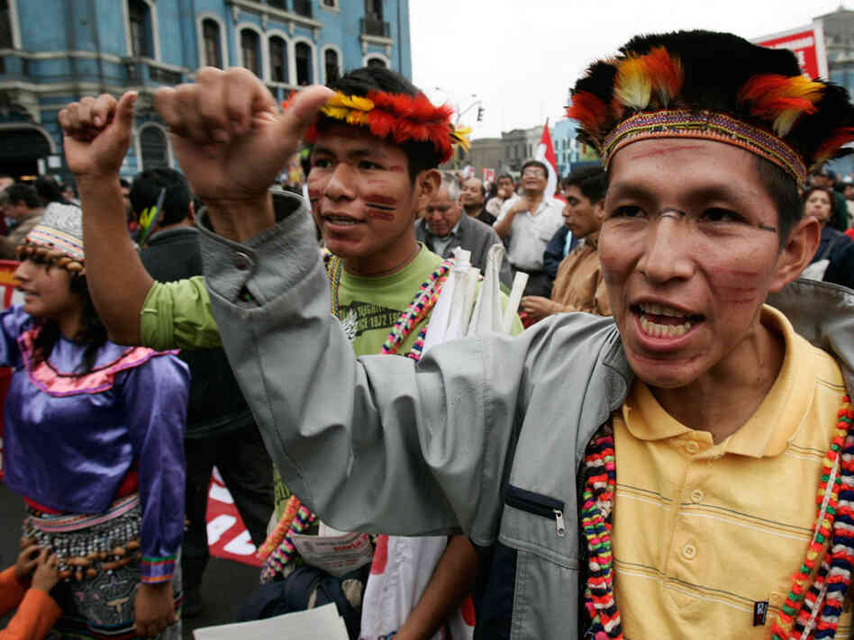 Indigenous people shout slogans during a protest.