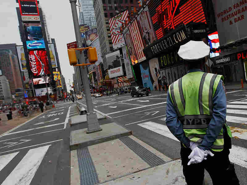 A New York City traffic policeman on his post in nearly empty Times Square