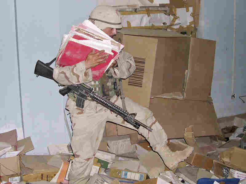 U.S. soldiers take away Iraqi government documents in June 2003