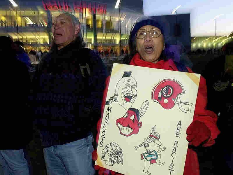 Jan Saiz and Hugh Danforth protest