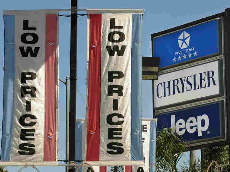 Signs at a Los Angeles Chrysler dealership.
