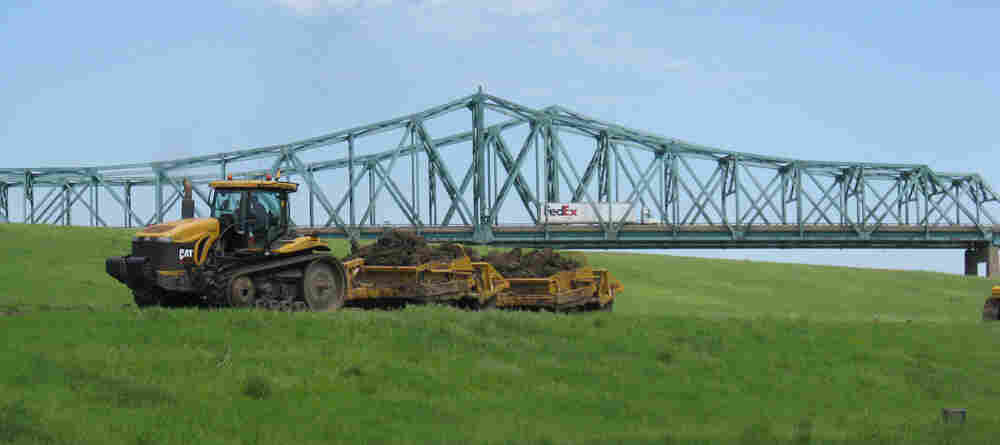 A tractor to performs maintenance on a levee in Granite City, Ill.