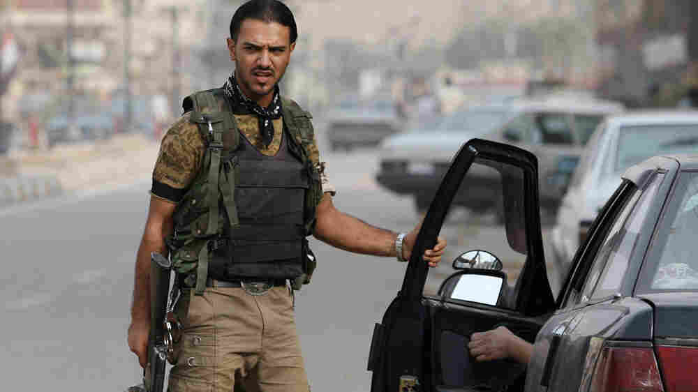Sons of Iraq volunteer at a checkpoint in Baghdad in 2008