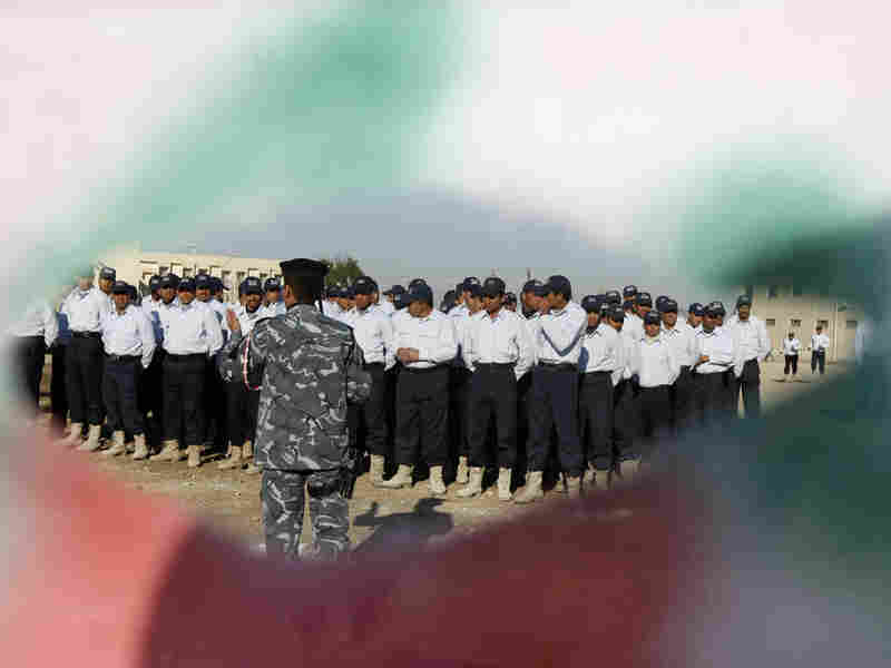 Graduation ceremony for Sons of Iraq militia at an Iraqi police training center in January 2009