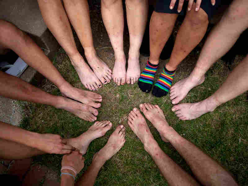 Hikers show their feet